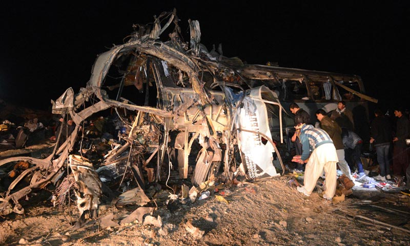 Rescue workers search the wreckage of a destroyed pilgrims bus after a bomb attack at Dringhar village on the Pakistan-Iran highway some 60 kilometres west of Quetta. -AFP Photo