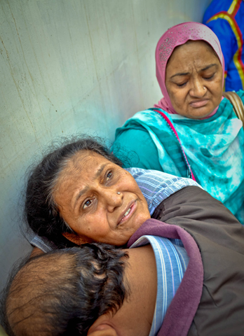 The mother (left) of Fahad Khaleel grieves inside the JPMC mortuary. -Photo by Fahim Siddiqi/White Star