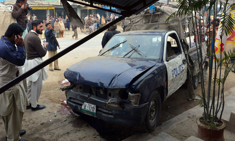A mangled police vehicle is pictured after a bomb attack in Sardheri, some 30 kilometres north of the main northwestern city of Peshawar on January 22, 2014.—AFP Photo