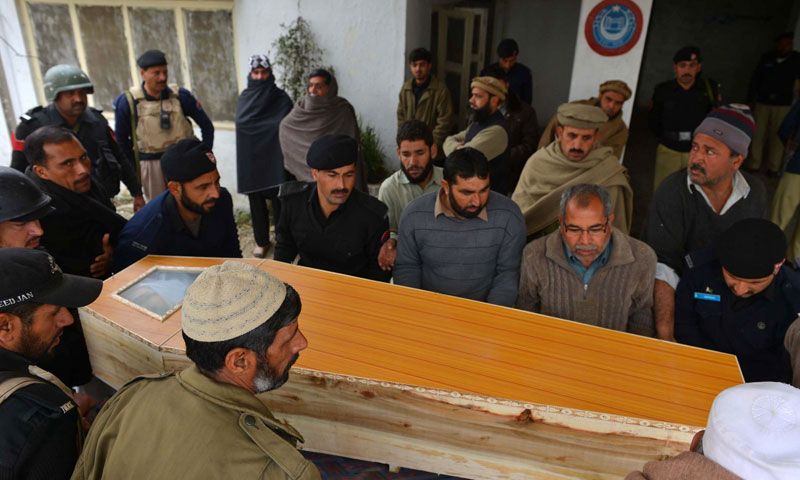 Relatives and colleagues carry the coffin of a policeman killed in a bomb attack in the city of Charsadda, some 25 kilometres north of of Peshawar on January 22, 2014.—AFP Photo