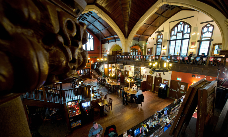 The interior of O'Neills pub in a former Presbyterian church in Muswell Hill, north London.