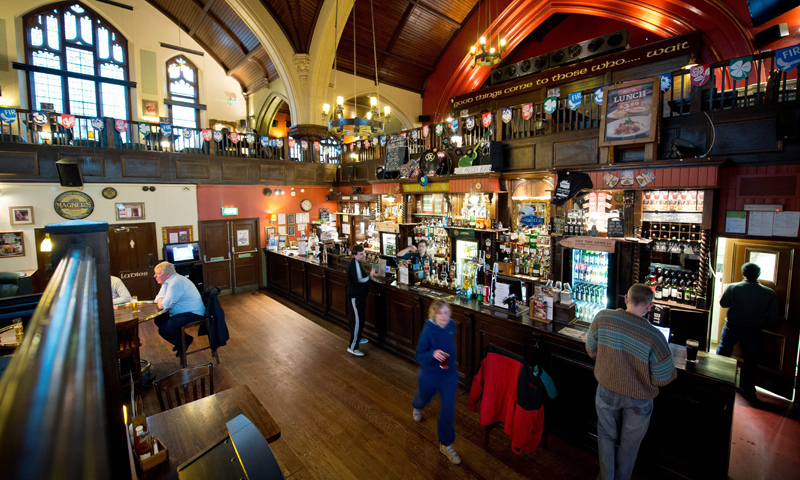 Another view of the interior of O'Neills pub in a former Presbyterian church in Muswell Hill, north London.