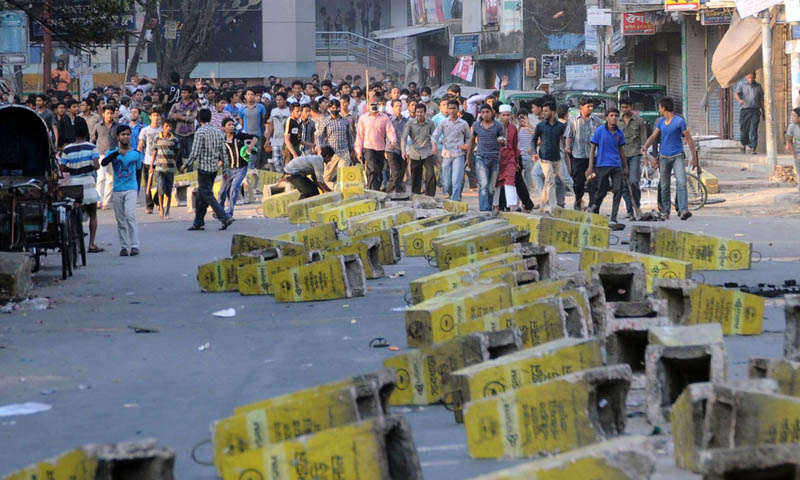 Activists of Jamaat-i-Islami set up road blocks during a strike called by the party in Chittagong, Bangladesh. – Photo by AP/File