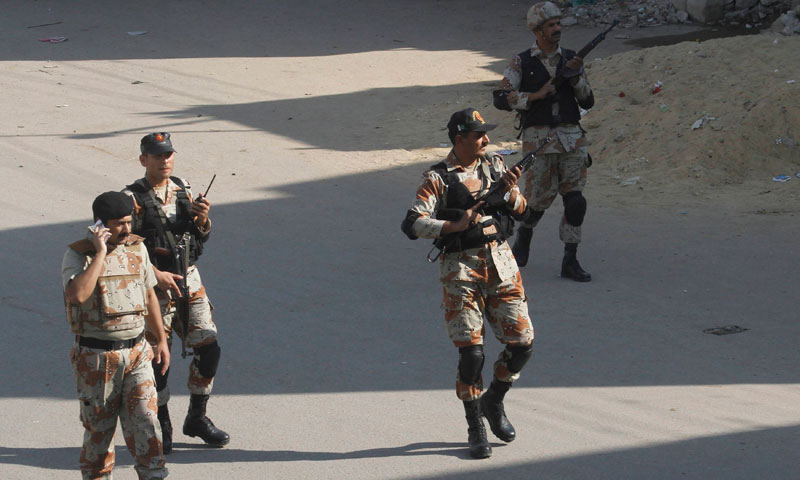 Rangers personnel patrol a street near the site of a bomb attack in Karachi January 29, 2014.—Reuters Photo