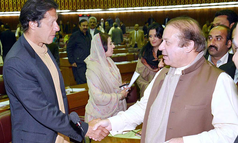 Prime Minister Nawaz Sharif shaking hand with PTI chief Imran Khan at National Assembly in Islamabad on Wednesday. – APP Photo