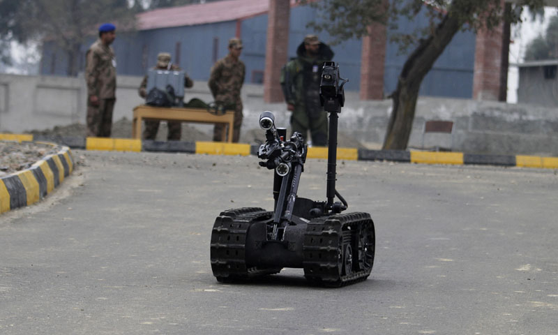 In this Wednesday, Jan. 8, 2014, photo, Pakistani soldiers use remote controlled vehicle to approach possible explosive devices during a training session at the Counter IED Explosives and Munitions School, in Risalpur, Pakistan. Soldiers of the Pakistani security forces learn exactly these types of scenarios to deal with the improvised bombs that have become increasingly popular in wars like Iraq, Afghanistan and the insurgency that Pakistan's forces are fighting in the northwestern tribal areas.— Photo by AP