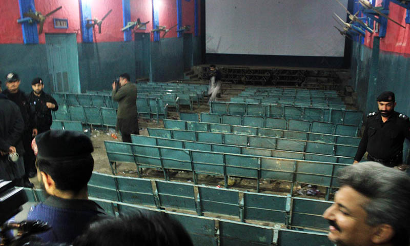 Policemen seen inside a cinema hall after two hand grenade blasts in Peshawar on Sunday. – Photo by Online
