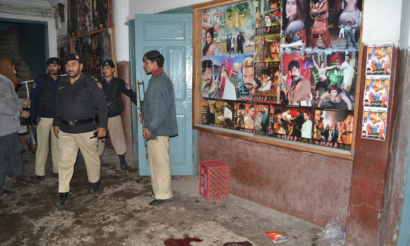 Policemen at a cinema hall after two hand grenade blasts ripped through it in Peshawar on Sunday. – Photo by Zahir Shah Sherazi