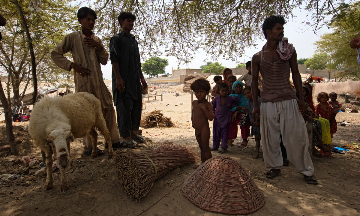Members of a fishing community displaying wicker baskets, one of their sources of income.— Photo by Kohi Marri