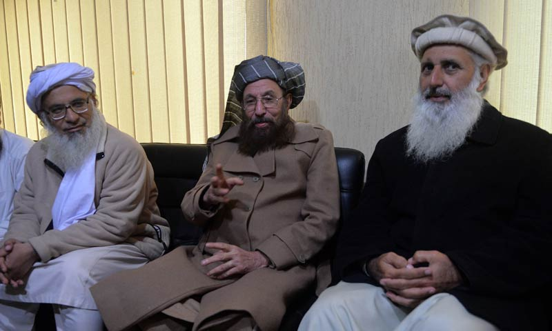 Chief cleric of Islamabad's Red Mosque, Maulana Abdul Aziz (L) and two senior religious party leaders, Maulana Samiul Haq (C) and Professor Mohammad Ibrahim, sit together after a meeting in Islamabad, Feb 3, 2014. The three are members of the Taliban-nominated committee set up to hold peace talks with the government's committee. — Photo by AFP