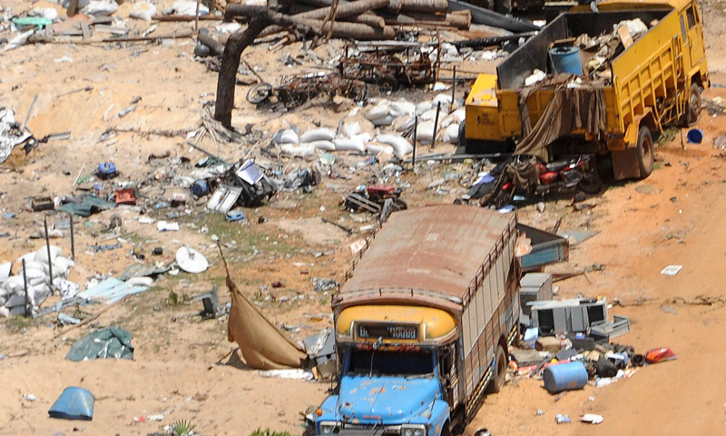A general view of destroyed trucks in the abandoned 'conflict zone' where Tamil Tigers separatists made their last stand before their defeat by the Sri Lankan army in the northeast of Sri Lanka.— Photo by AFP