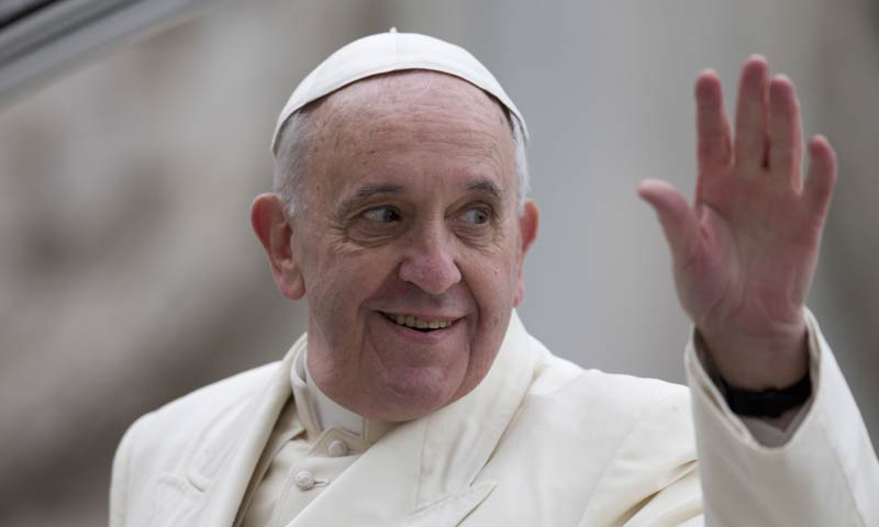 Pope Francis waves as he leaves at the end of  his weekly general audience in St. Peter's Square at the Vatican. -AP Photo