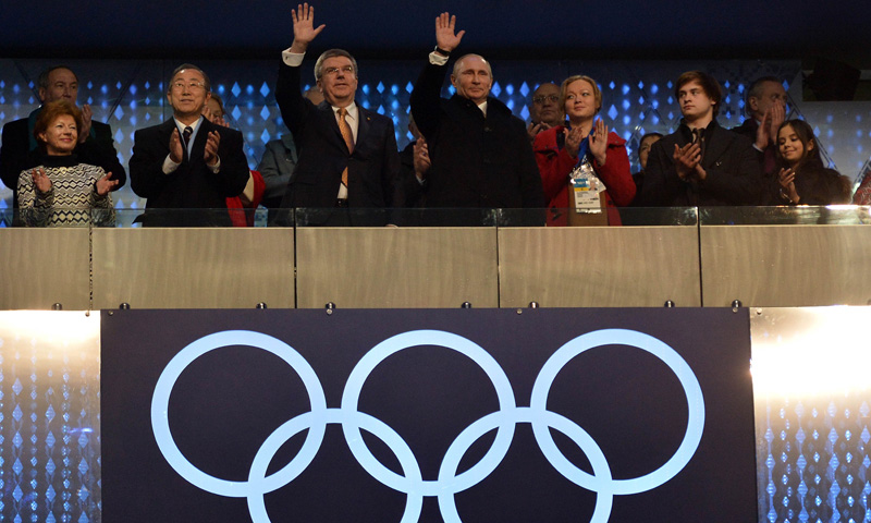 Russia's President Vladimir Putin C-R) and IOC President Thomas Bach (C-L) wave during the Opening Ceremony of the Sochi Winter Olympics at the Fisht Olympic Stadium on February 7, 2014 in Sochi. – AFP Photo