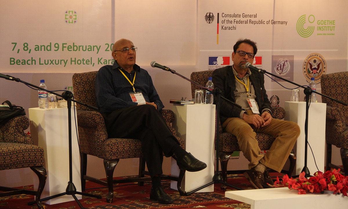 Amjad Islam Amjad (L) with moderator, Muhammad Ahmed Shah. – Photo by Aliraza Khatri