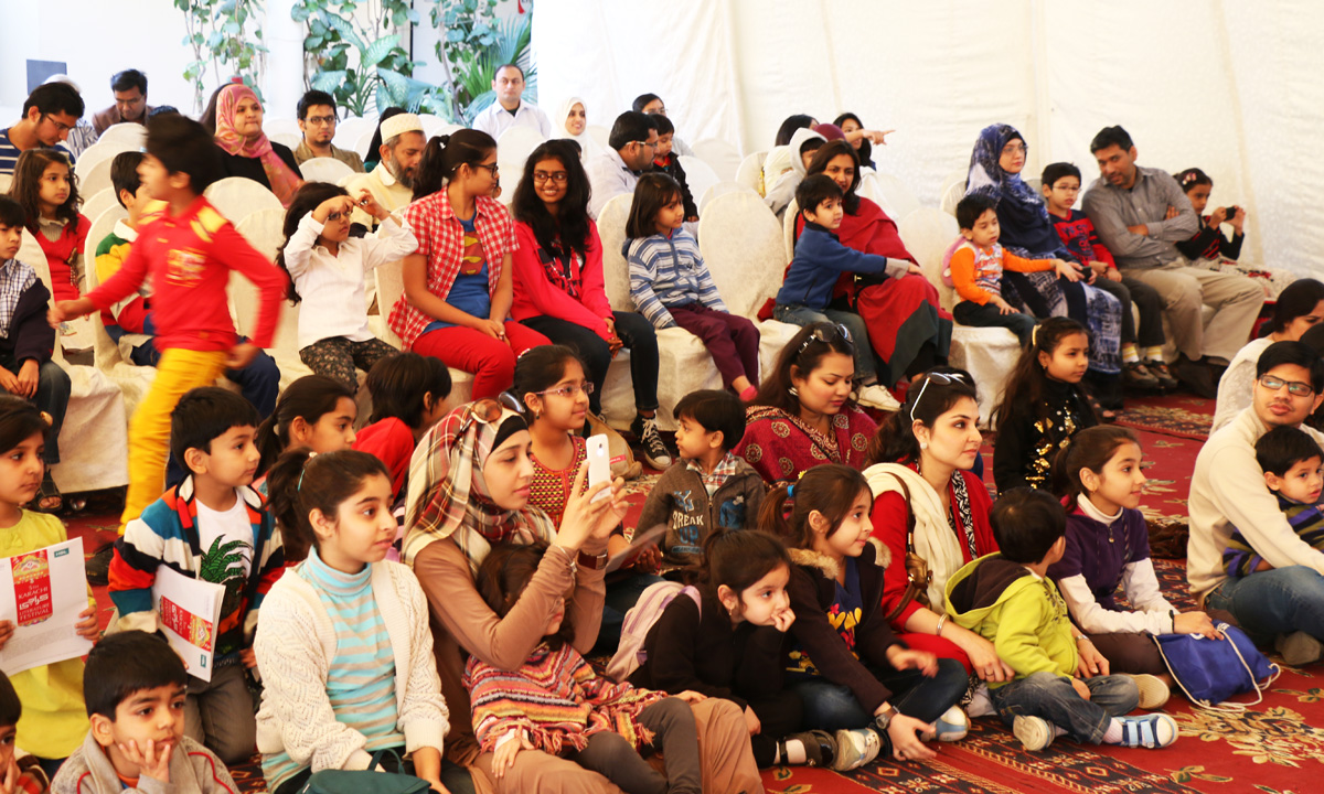 Children enjoying the puppet show by Ritz Theatre. – Photo by Kurt Menezes