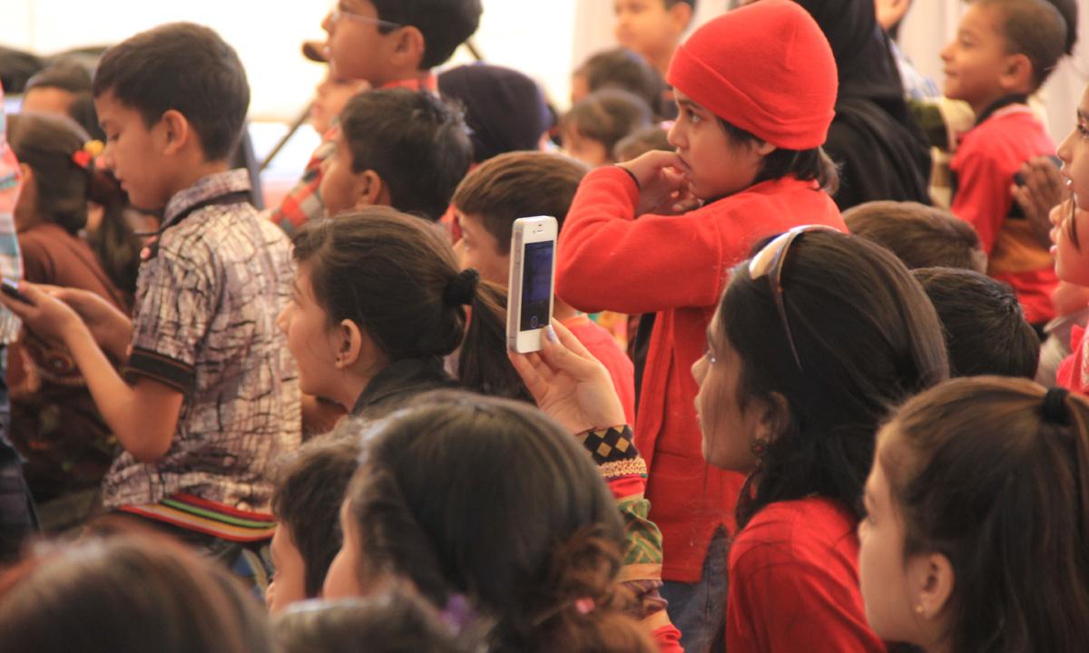 Visitors at the puppet show. – Photo by Aliraza Khatri