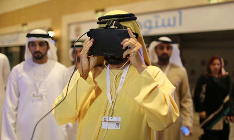 United Arab Emirates' Prime Minister and Ruler of Dubai Sheikh Mohammed bin Rashid al-Maktoum looks through a visor as he tests an unmanned aerial drone during Virtual Future Exhibition, in Dubai February 9, 2014. — Photo by Reuters