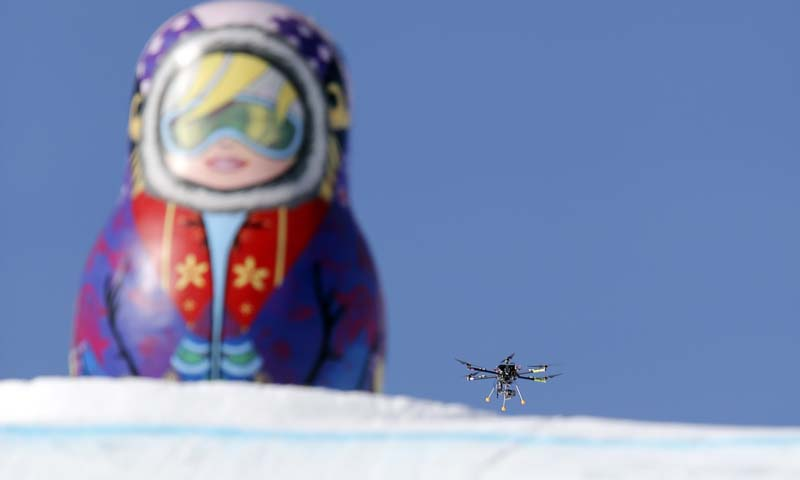 In this Friday Feb. 7 photo, a drone camera  flies about the slopestyle course during a freestyle skiing slopestyle training session at the Rosa Khutor Extreme Park ahead of the 2014 Winter Olympics, Friday, Feb. 7, 2014, in Krasnaya Polyana, Russia.— Photo by AP