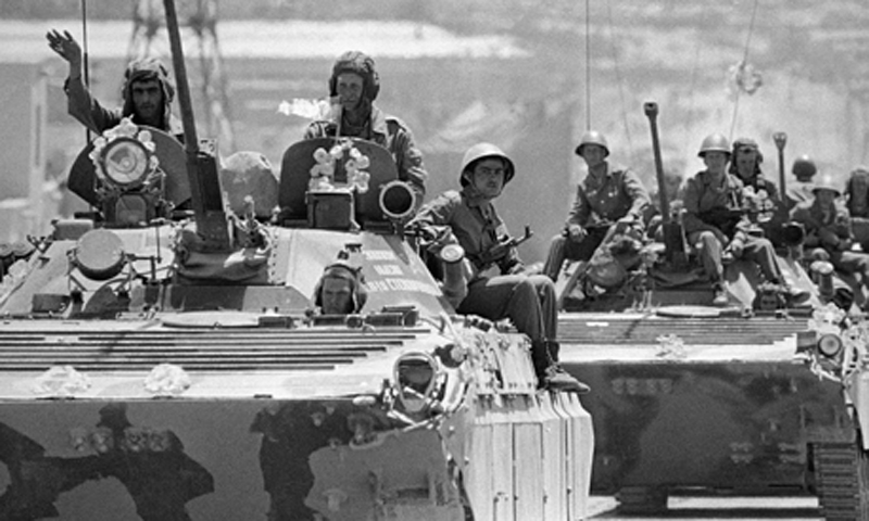 In this May 16, 1988 file photo, a convoy of tanks and armored personnel carriers roll out of Kabul, heading north back to the Soviet Union. – AP Photo/File