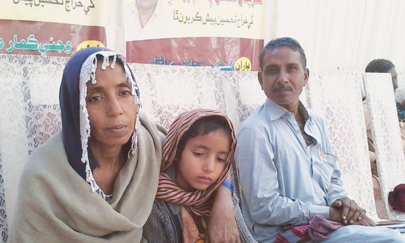 Jumna with parents at the Karachi Press Club on Sunday. — Photo by writer
