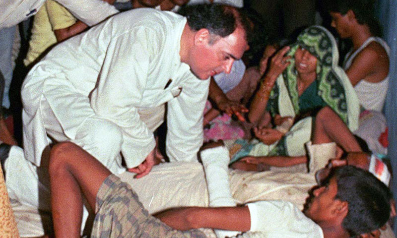 In this 1991 file photo, former Indian Prime Minister Rajiv Gandhi, center, leaning in, listens to the grievances of a man while campaigning for election in a town in central India, a few days before he was assassinated. — Photo by AP