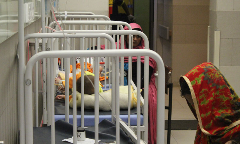 A row of baby cots lined up in the recovery room of the emergency care unit at NICH. -Photo by Asif Umar.