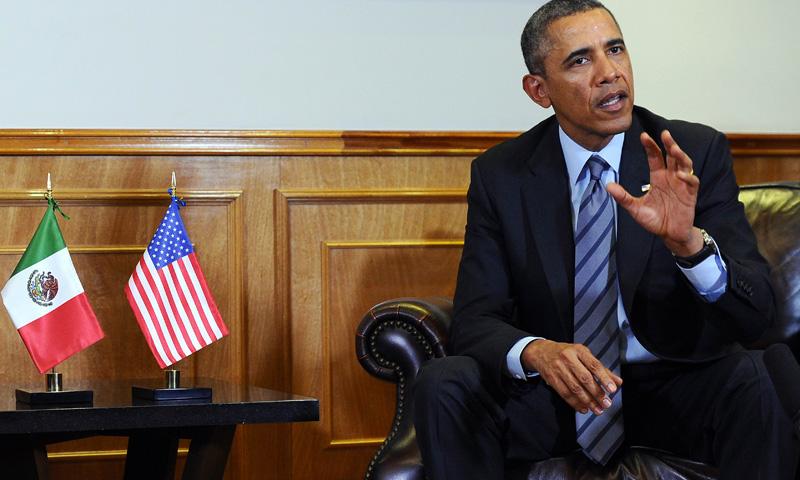 US President Barack Obama speaks during a bilateral meeting with Mexican President Enrique Pena Nieto (not in frame) at the Palacio de Gobierno del Estado de Mexico in Toluca, Mexico, on February 19, 2014. – AFP Photo
