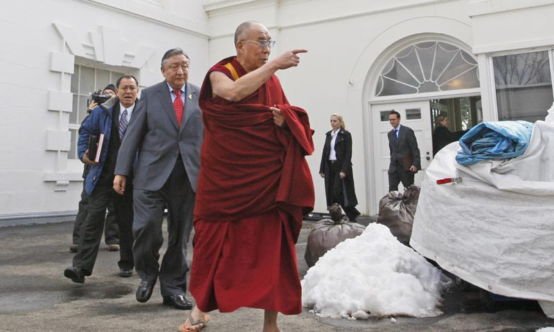 In this Feb. 18, 2010, file photo, The Dalai Lama walks out of the White House in Washington, after meeting with President Barack Obama. -AP Photo