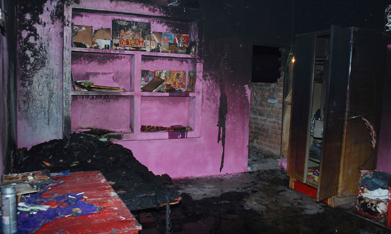 In this picture, the burnt  house of Bunty Sharma, 32, an auto rickshaw driver, is seen, in Agra, India. — Photo by AP