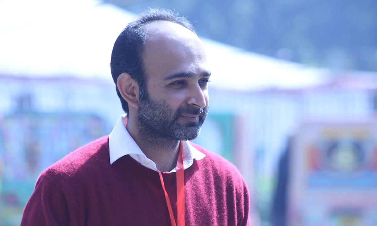 Mohsin Hamid caught outside in the garden at Alhamra Art Center. – Photo by Hamza Cheema
