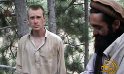 This file image provided by IntelCenter on Wednesday Dec. 8, 2010 shows a frame grab from a video released by the Taliban containing footage of a man believed to be Bowe Bergdahl, left.— Photo by AP