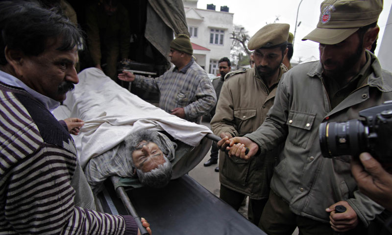 The body of Showkat Ali, a Pakistani national who was held in an Indian prison, is brought to the government medical hospital for a post-mortem in Jammu on February 22, 2014. — Photo by AFP