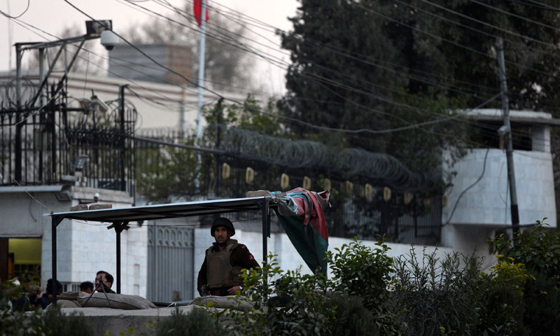 Security personnel stand guard outside the Iranian consulate following a suicide bomb attack in Peshawar on February on February 24, 2014. – AFP Photo