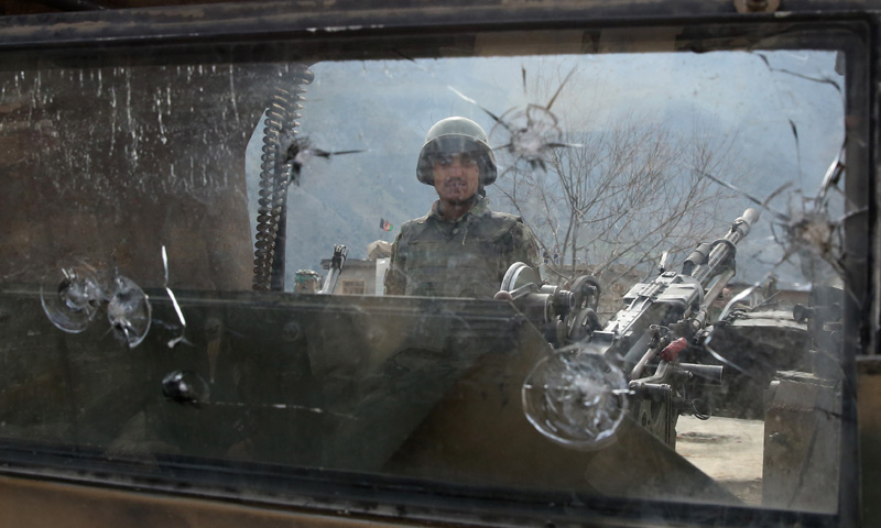 Afghan National Army (ANA) soldier stands guard on a military vehicle in Narai military camp in Ghazi Abad district on Monday, Feb. 24, 2014. – AP Photo