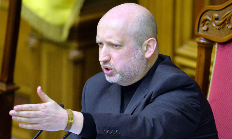 Parliament Speaker and interim president of Ukraine, Oleksandr Turchinov, gestures while speaking during a session in Kiev, Feb 23, 2014. — Photo by AFP