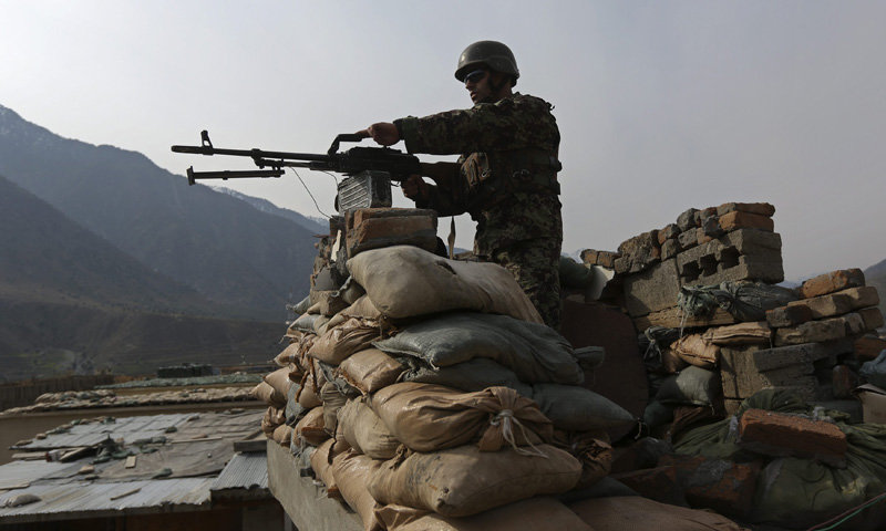 An Afghan National Army (ANA) soldier keeps watch at the Forward Base in Nari district near the army outpost in Kunar province, February 24, 2014. – Reuters Photo