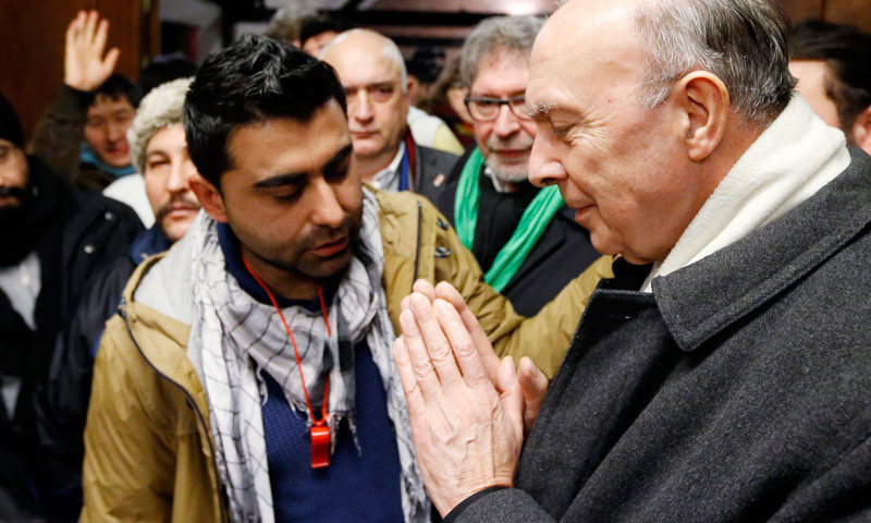 Archbishop of Mechelen-Brussels and Primate of Belgium Andre-Joseph Leonard (R) meets Afghan asylum seekers at the abbey of Affligem during their march from Brussels to Ghent, to protest against Belgium's refusal to grant them residency papers.