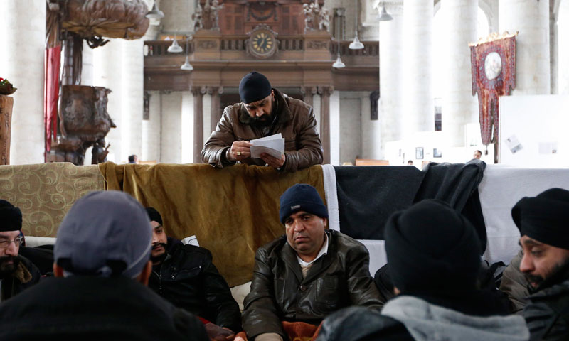 Sikh men from Afghanistan sit on their beds inside the Church of Saint John the Baptist at the Beguinage in central Brussels.