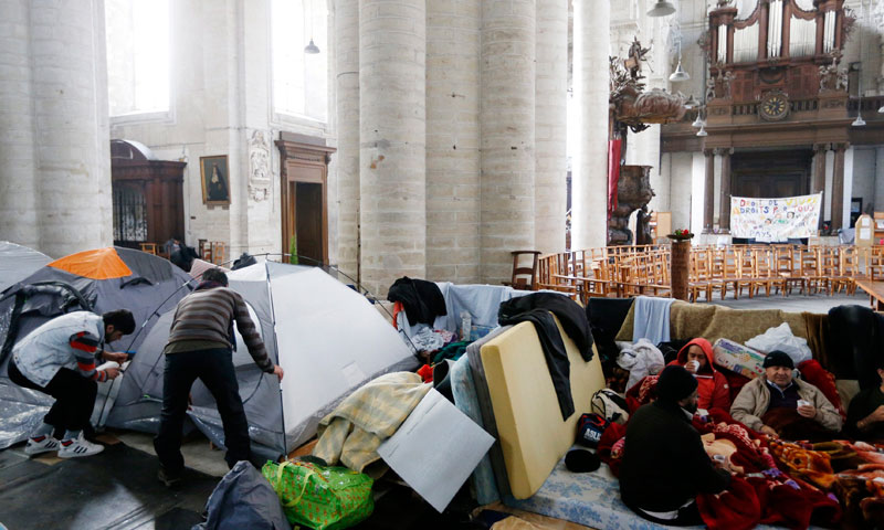 Asylum seekers from Afghanistan set up a tent inside the Church of Saint John the Baptist at the Beguinage in central Brussels.