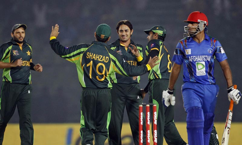 Pakistan's Saeed Ajmal, center facing camera, celebrates the dismissal of Afghanistan's Noor Ali Zadran with teammates during the Asia Cup one-day international cricket tournament between them in in Fatullah. -AP Photo