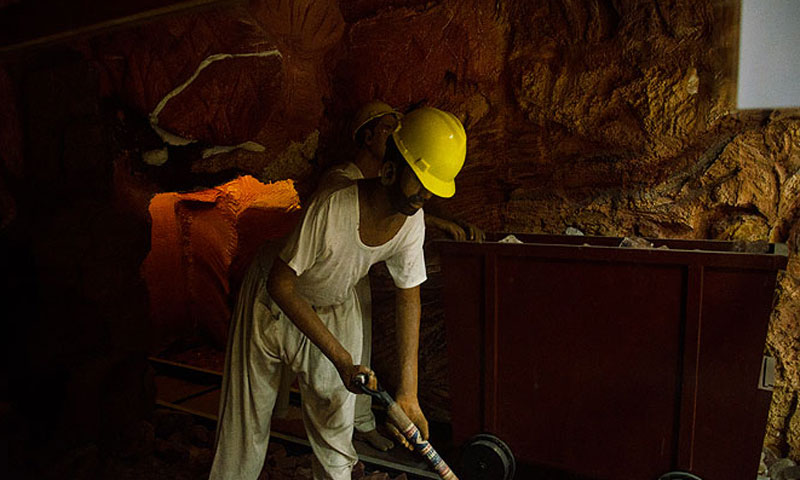 A worker at work in the Khewra salt mines. — File photo