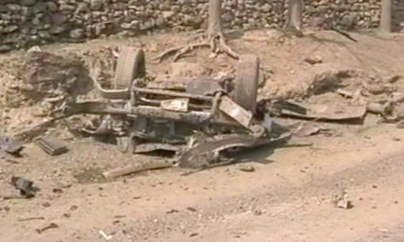 Image taken from television footage shows the wreckage of a vehicle from Saturday's attack on a polio vaccination team in Jamrud, Khyber agency.—Photo by Zahir Shah Sherazi