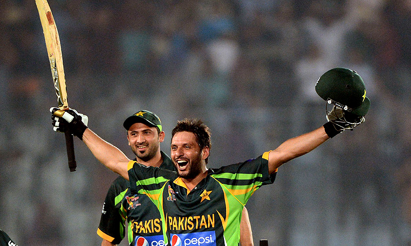 Pakistan cricketer Shahid Afridi reacts (R) and Junaid Khan (L) looks on after winning the sixth match of the Asia Cup one-day cricket tournament. – Photo by AFP