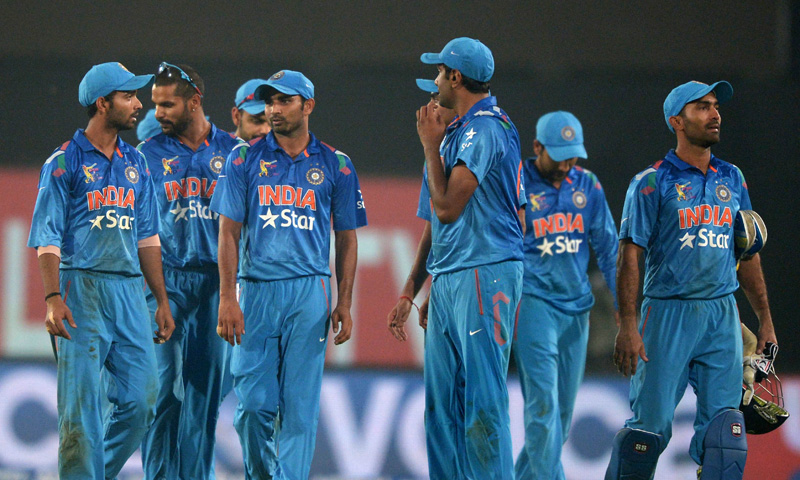 Indian cricketers return to the dressing room after losing the sixth match of the Asia Cup one-day cricket tournament between India and Pakistan at the Sher-e-Bangla National Cricket Stadium in Dhaka on March 2, 2014. – AFP