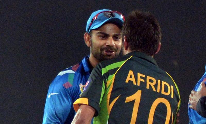 Indian captain Virat Kohli (L) congratulates Shahid Afridi for their team's win in Dhaka on March 2, 2014. – AFP