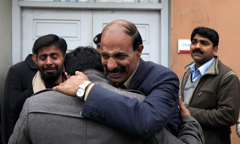 People mourn over the death of their relative, a victim of a bombing, outside the morgue of a local hospital in Islamabad, March 3. — AP