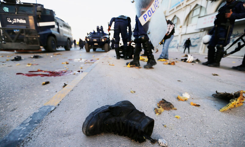 The boot of a riot-police official lies on the road at the scene where a homemade bomb exploded  in Bahrain, leaving three policemen dead. — Photo by Reuters