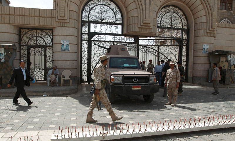 Yemeni soldiers stand guard outside the cabinet headquarters during the weekly parliament session with Yemeni ministers in Sanaa. — Photo by AFP