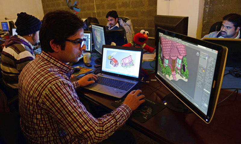 "Pakistani game designers work at the game studio ""We R Play"" in Islamabad. — Photo by AFP"