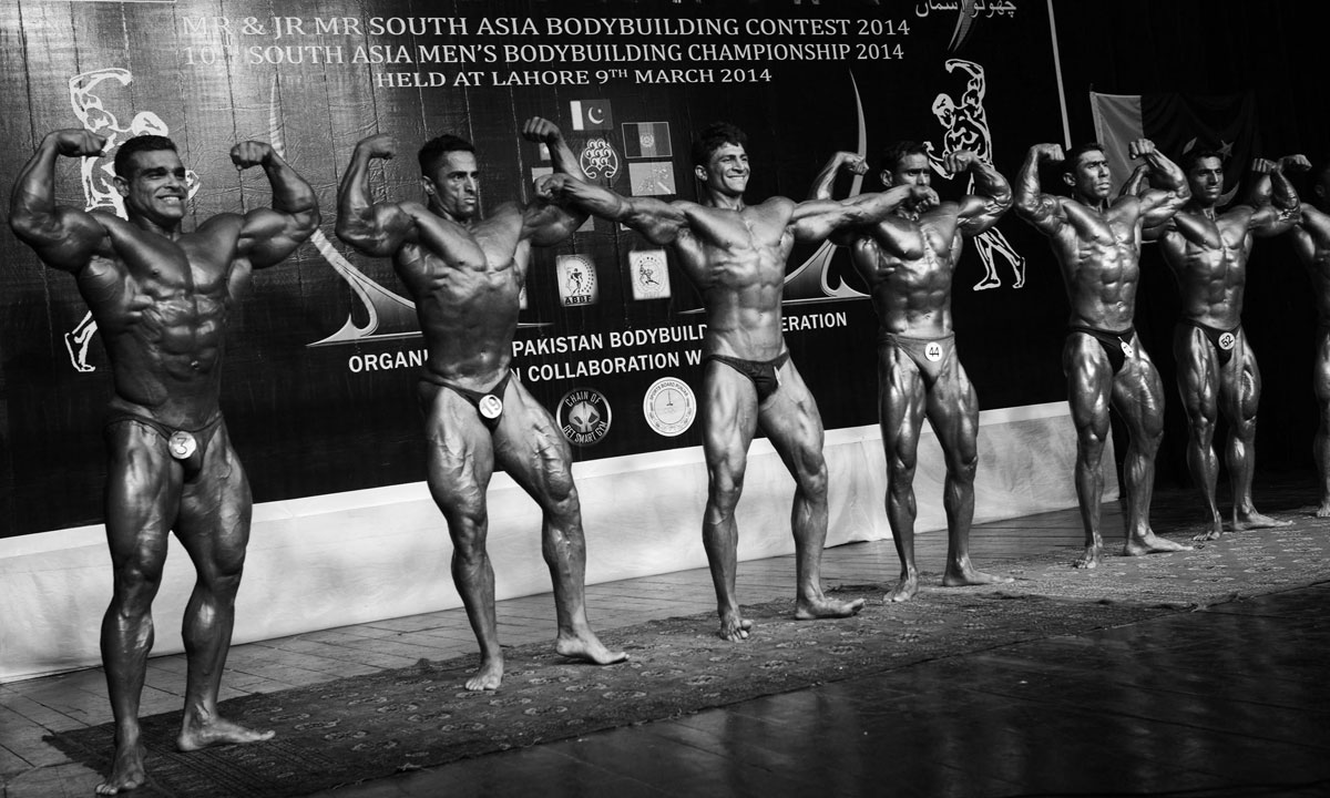 Bodybuilders compete in the 10th South Asian Men's bodybuilding championship in Lahore on March 9, 2014. – Photo by AFP